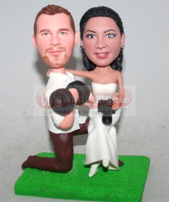 Groom lifting dumbbells cake toppers