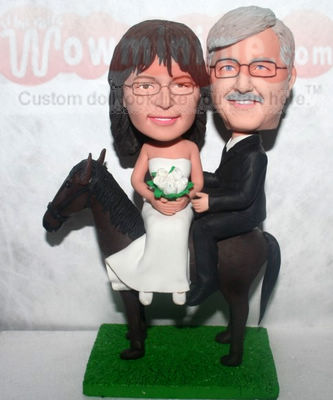 Ridding on horse Cake Toppers