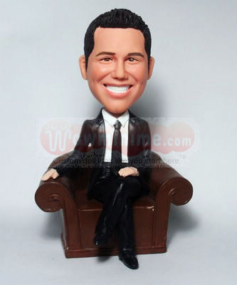 Sitting on couch figurine