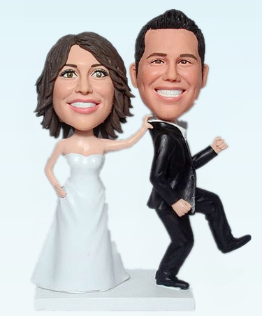 Custom cake toppers bride seizing groom - Click Image to Close